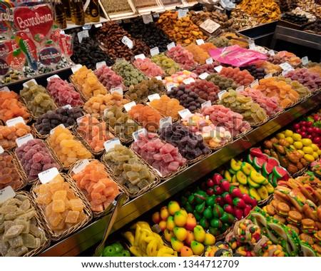 La Rambla Markets, Barcelona, Spain: Stall selling colorful lollies, sweets and snacks at the La Boqueria markets - a large public market in the Ciudad Vieja district of Barcelona, Catalonia, Spain.