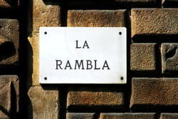 La Rambla- street sign depicting one of the first landmark in Barcelona (Spain).
