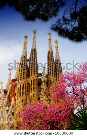 La Sagrada Familia in Barcelona with pink spring blossom