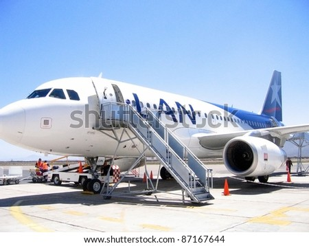 LA SERENA, CHILE-OCT. 16: Chilean airlines LAN's Airbus A318 parks at La Florida Airport in La Serena, Chile on Oct. 16, 2007. La Serena is the 4th largest city in Chile. LAN is merging with Brazilian airlines TAM, by middle 2012.