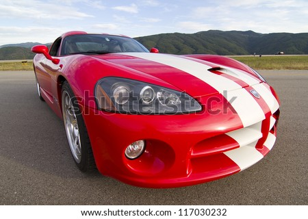 LA SEU D'URGELL, SPAIN - OCTOBER 6: A Dodge Viper SRT take part in Road and Track racing weekend organizated by American Car Club, on October 6, 2012, in the airport of La Seu d'Urgell, Spain.