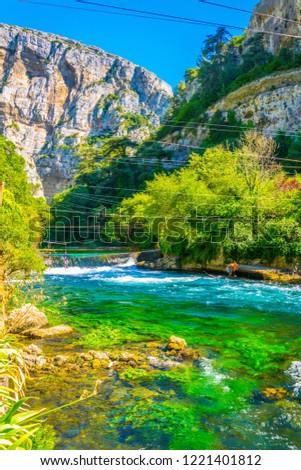 La sorgue river passing through Fontaine de Vaucluse village in France #1221401812