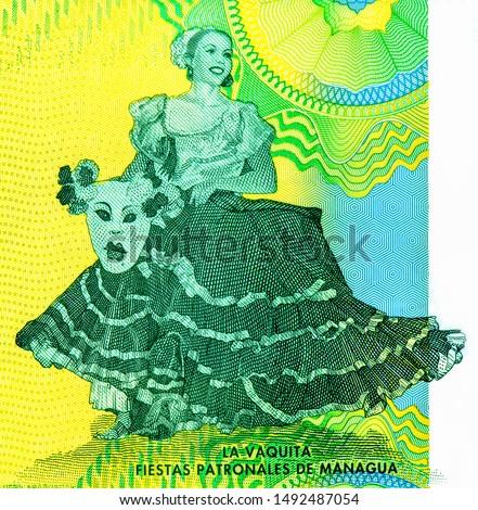 La Vaquita dancer. Managua Patron Saint Festivities. portrait from Nicaragua 10 Cordobas 2014 Banknotes. Nicaraguan money Closeup Collection. #1492487054