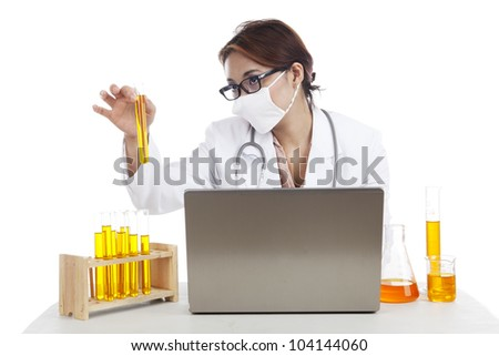 Lab asistant working in laboratory with laptop and test-tubes