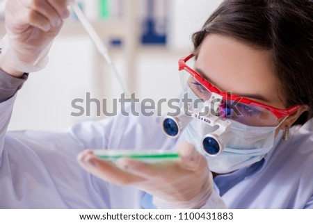Lab assistant in drug synthesis concept