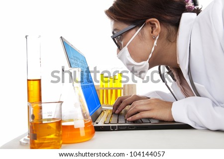 Lab assistant woman works with laptop and test-tubes in laboratory