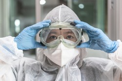 Lab goggle, eye protection, ppe cover and surgical glove for medical doctor, research scientist, surgical surgeon, personal protective equipment for covid-19 virus, coronavirus for hygience safety