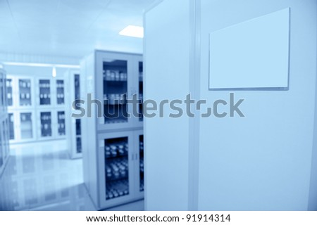 Lab interior with many cabinets with bottles.