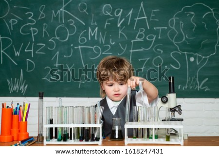 Lab microscope and testing tubes. Knowledge day. They carried out a new experiment in chemistry. Experiment. Back to school