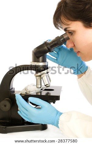 Lab Tech looking in the microscope shot over white background