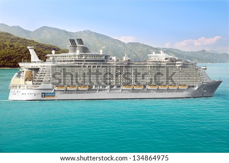 LABADEE, HAITI - FEBRUARY 26, 2013: Royal Caribbean cruise ship Allure of the Seas  Sails from Port Labadee in the Caribbean Island of Haiti on February 26, 2013. It's the largest passenger ship