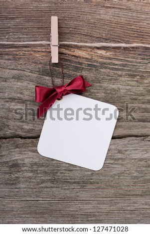 label and red loop on wooden ground/christmas/label