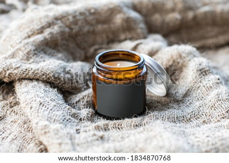 Label mockup of the glass jar with handmade candle on the coarse textile background Photo stock ©