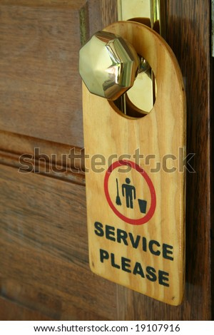 "label on a door with writing ""service please"""
