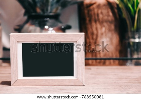 label or Blank picture frame template set for Photo or picture painting art gallery in interior on the table. acrylic tent card Used for Menu Bar and restaurant or put everything into it . mockup
