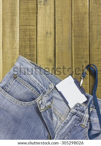 label tag and jeans on wood background.