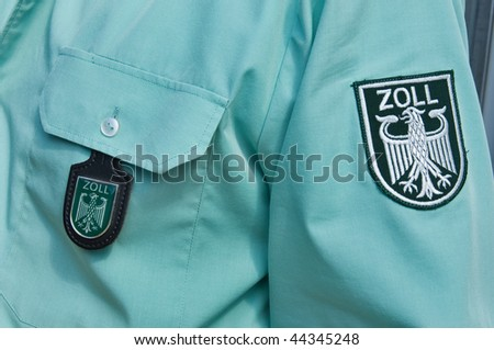 Labels on the shirt of a german custom officer