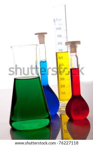 Labolatory glassware with colorful fluids isolated on white