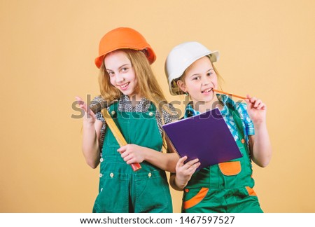 Labor day. 1 may. Foreman inspector. Repair. happy children. Future career. small girls repairing together in workshop. Little kids in helmet with tablet and hammer. work uniform. builder uniform.
