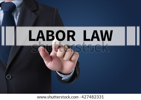 LABOR LAW Businessman hands touching on virtual screen and blurred city background #427482331