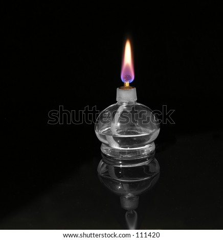 Laboratory alcohol burner on a black background.  Reflection is clearly visible.