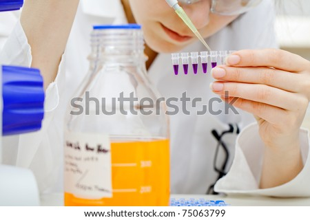 laboratory assistant analyzing a blood sample
