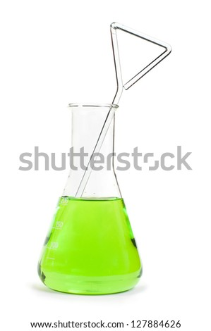 Laboratory beakers filled with green color liquid substances