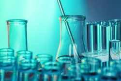 Laboratory chemistry glassware  on green toned background