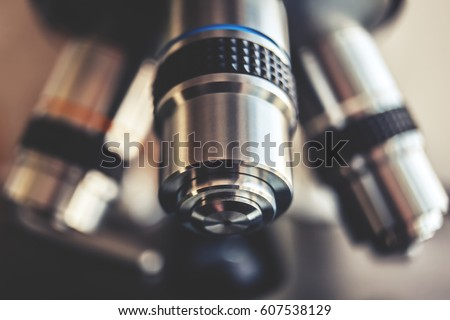Laboratory Equipment - Optical Microscope. Microscope is used for conducting planned, research experiments, educational demonstrations in medical and health institutions, laboratories. Close up photo.