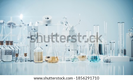 Laboratory equipment. Vaccine production in the laboratory. Chemical laboratory glassware. Lab graduated glassware filled with different color reagents. 3d render