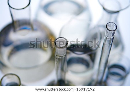 laboratory flasks on turn blue background