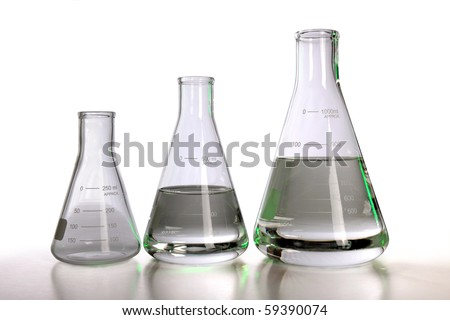 Laboratory flasks over white background with table reflections - With clipping path - stock photo