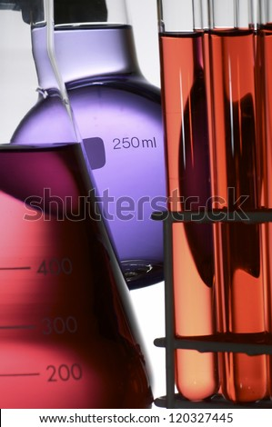 laboratory flasks with colored liquid chemical inside