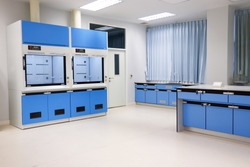 Laboratory fume hoods in science classroom interior of university college for protect the user from inhaling toxic gases (fume hoods, biosafety cabinets, glove boxes).