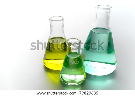 Laboratory glass conical Erlenmeyer flasks filled with chemical liquid for a chemistry experiment in a science research lab