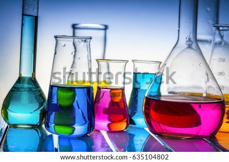 Laboratory glass filled with colorful substances. Chemical liquids analysis and testing.