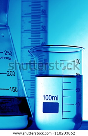 Laboratory glassware in blue tone