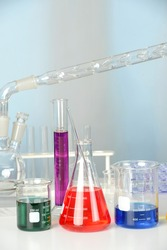 Laboratory glassware on table with flasks and beakers and distillation set