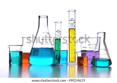 Laboratory glassware over white background with reflections on surface