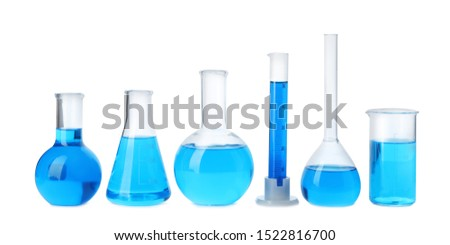 Laboratory glassware with blue liquids isolated on white #1522816700