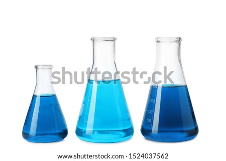 Laboratory glassware with blue liquids isolated on white #1524037562