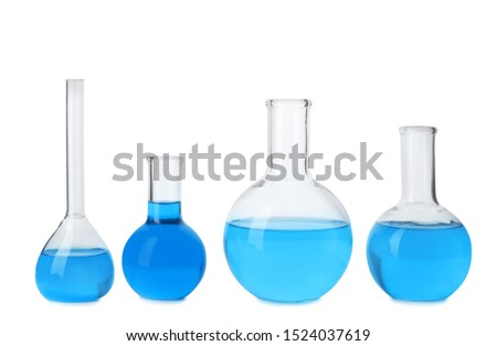 Laboratory glassware with blue liquids isolated on white #1524037619