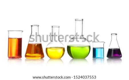 Laboratory glassware with color liquids on white background #1524037553