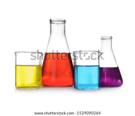 Laboratory glassware with color liquids on white background #1529090264