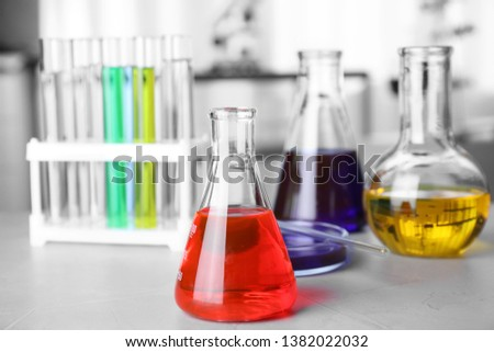 Laboratory glassware with samples on table indoors, space for text. Solution chemistry #1382022032