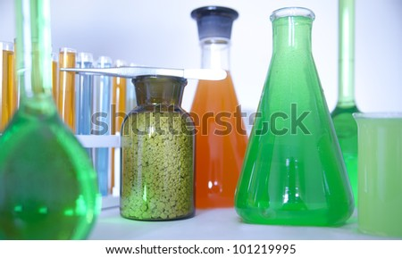 Laboratory glassware with various colored liquids  chemical glass