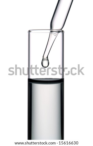 Laboratory pipette with drop of clear liquid inside a glass test tube for an experiment in a science research lab