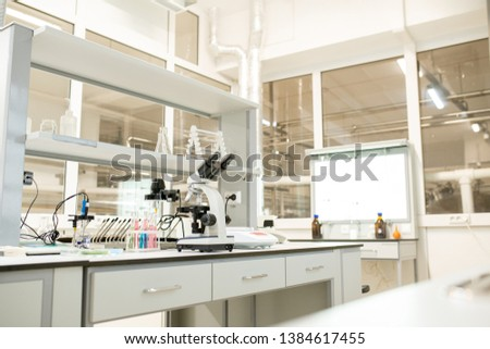Laboratory place with glassware, modern devices and optical instruments used for scientific research