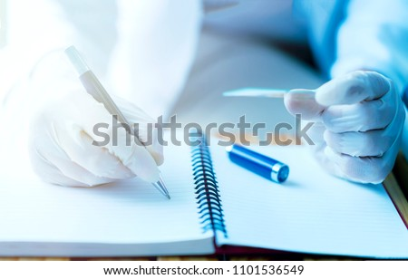 Laboratory, scientist concept. Doctor writing test note on notebook after doing medical research and development for microbiology in lab. Professional chemistry biology healthcare for medicine