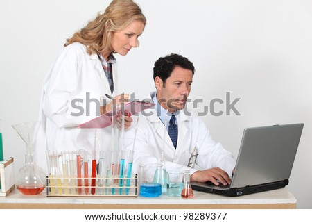 Laboratory workers and equipment - stock photo